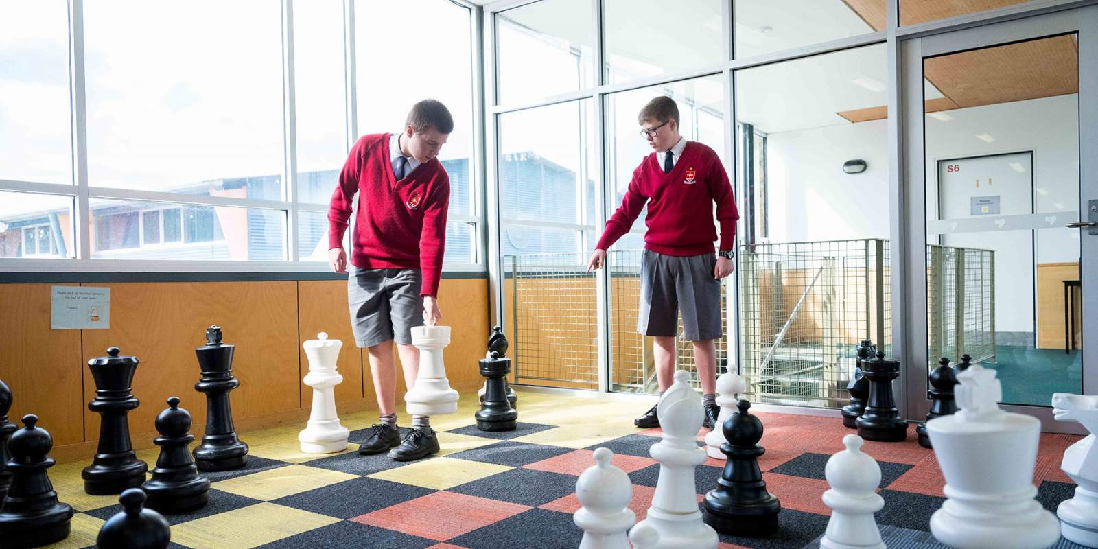 Students in Rice Resource Centre playing Chess