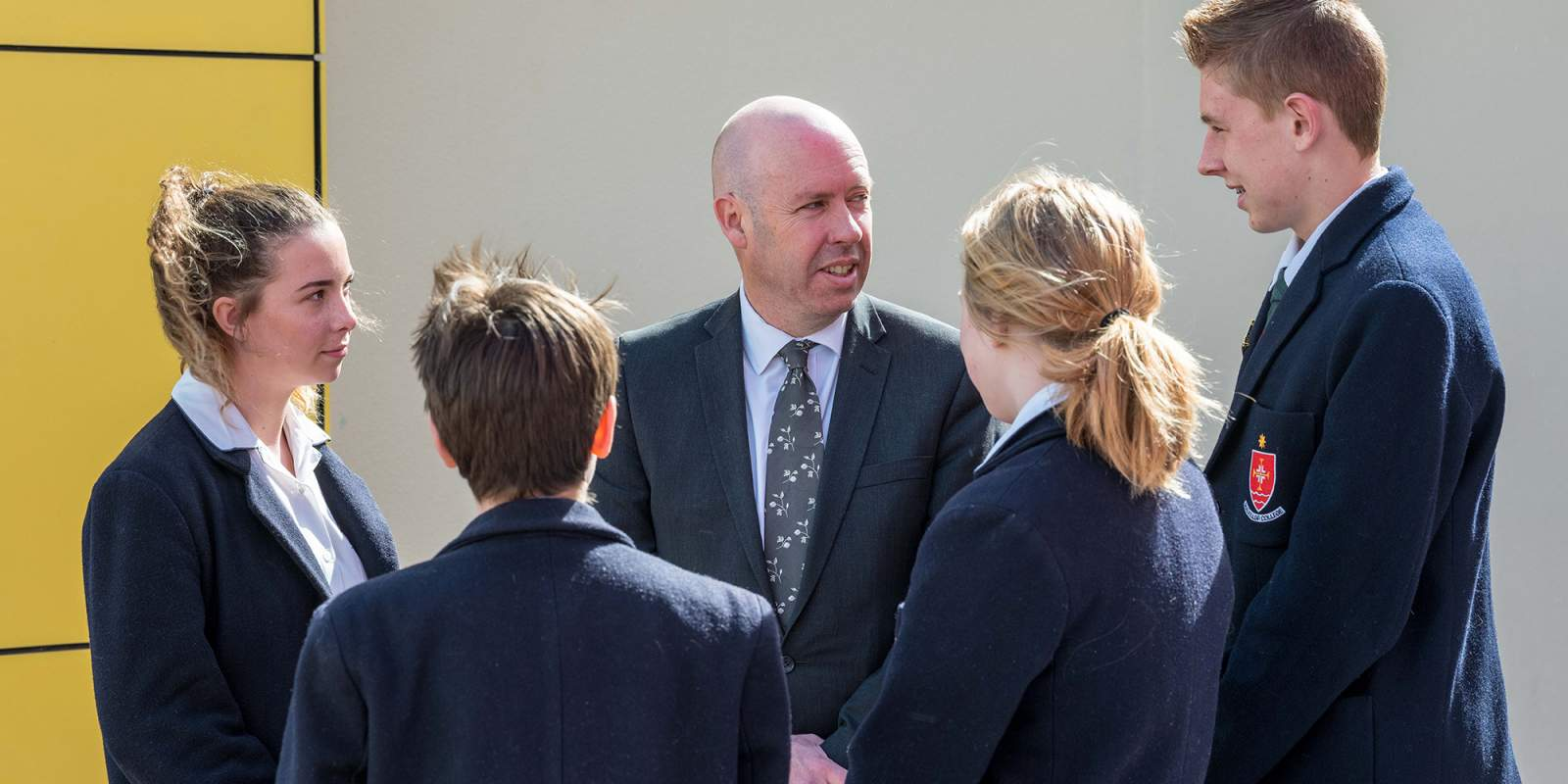 Principal Eamonn Pollard talking to students